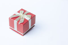 Single red gift box with ribbon on white background Stock Images