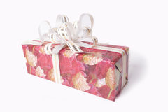 Single red gift box with silver ribbon Royalty Free Stock Photography