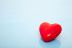 Single red heart. On blue background Royalty Free Stock Images