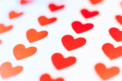 Single red heart in focus between many others. Single red heart in focus between many other hearts concept of many different love Royalty Free Stock Photography