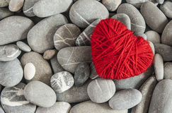 Red heart of the spa stones. Single red heart on pebble stones Royalty Free Stock Images