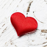 Single red heart. On white wood background Stock Images