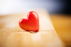 Single red  heart on wood for Valentine's Day. Close up of a single red  hearts on wood for Valentine's Day Stock Image