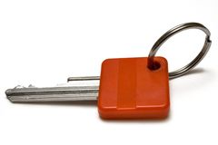 Single Red Key w/ Ring. Key with space for text against white background Stock Photography