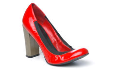 Single red pump. A single red woman shoe on white isolated background Stock Photo