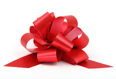 Single red ribbon. Plastic gift bow isolated on white background Royalty Free Stock Photo