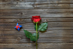 Single red rose with a Valentines gift Stock Images