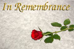 Single red rose on a white background with the inscription `In Remembrance` to the top