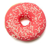 Pink, red Donut with sugar sprinkles. Single red sugar coated doughnut with sprinkles. on white background royalty free stock image