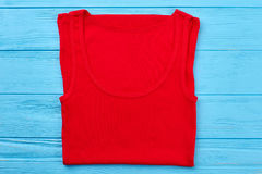 Single red t-shirt, vintage board. Stock Image
