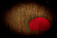 Single red thread heart  on Dark wood background Royalty Free Stock Photo