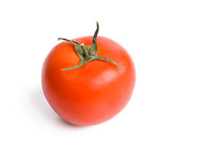 Single red tomato isolated on white Royalty Free Stock Images