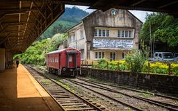 Single red train carriage waiting at Nanu Oya station in Sri Lanka. On 24 September 2016 royalty free stock images