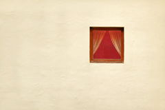 Single Red Window With Curtains In Whitewashed Wall Stock Photo