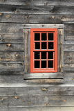 Single Red Window With Twelve Panes Of Glass In Weathered Barn Wall Stock Photography