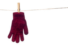 Single red winter glove hanging on a clo Stock Photography