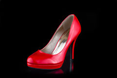 Single red woman high heel shoe isolated on black Stock Images