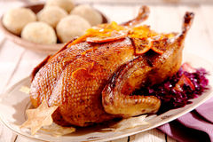 Single roasted chicken with star crackers Stock Image