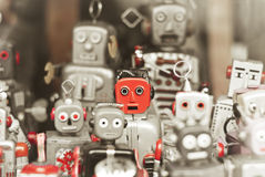 Single robot, standing out among the mass of robots Royalty Free Stock Photos