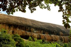 A single rock of sittanavasal cave temple complex. Sittanavasal is a small hamlet in Pudukkottai district of Tamil Nadu, India. It is known for the Sittanavasal Royalty Free Stock Photo