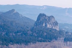 A single rocky mountain in a forest royalty free stock images