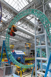 A single roller coaster car races around at the Mall of America Royalty Free Stock Photography