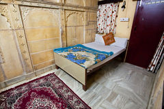 Single room with a bed and carpet Royalty Free Stock Photo