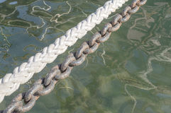 Single rope line and anchor chain Royalty Free Stock Images