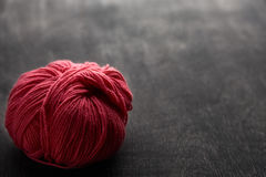 Single rose ball of yarn with soft focus. Single rose ball of yarn on wooden background with soft focus Stock Image