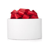 Single round gift box with red ribbon bow Stock Photos
