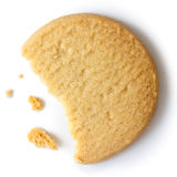 Single round shortbread biscuit with crumbs and bite missing. Fr Stock Photography