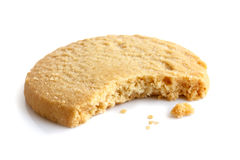 Single round shortbread biscuit with crumbs and bite missing. In Stock Images
