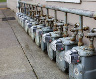 Single Row of gas meters. Row gray gas meters at an apartment complex Royalty Free Stock Photos