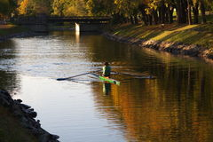 Single rower in a canal Royalty Free Stock Images