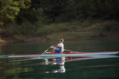 Single rower at sunrise. At the lake Stock Photo