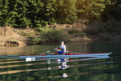 Single rower at sunrise. At the lake Stock Photography