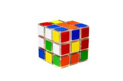 Single rubik's cube. On white surface stock photos