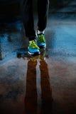 Single runner running in rain Royalty Free Stock Image