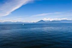 Single sailboat on open ocean stock image
