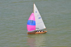 Single Sailing Boat. Taken from the Isle of Wight Ferry royalty free stock image