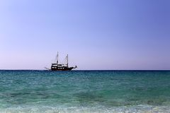 Single sailing ship at open sea under clear sky Royalty Free Stock Images