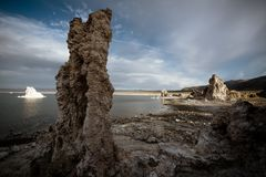 An obelisk in Mono Lake California. A single salt rock obelisk stands on the shore of Mono Lake in California royalty free stock photography
