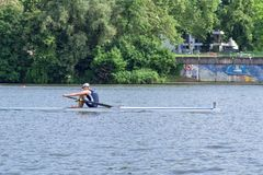 Single scull rowing competitor on the Neckar River during the boat racing Heidelberg Regatta 2018 royalty free stock image