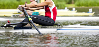Single scull women's rowing start Stock Photography