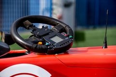Single seater formula racing car steering wheel detail Stock Photo