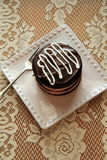 Single serving of double chocolate cake with white chocolate drizzle Stock Photos