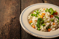 Single serving of rice and veggies on wood table Stock Images