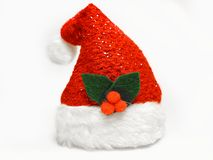 Single shimmering Santa Claus red hat with mistletoe isolated on white background Stock Images