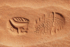 Single shoe print in sand Royalty Free Stock Images