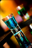 Single Shot. Of blue curacao on bar Royalty Free Stock Photos